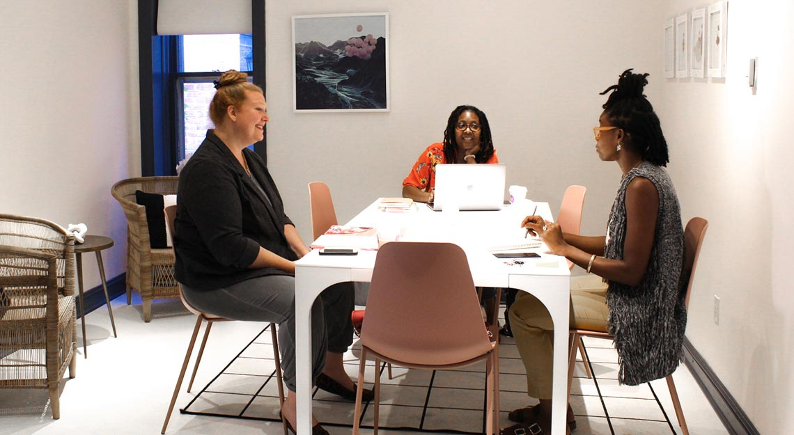 3 Women sitting at table